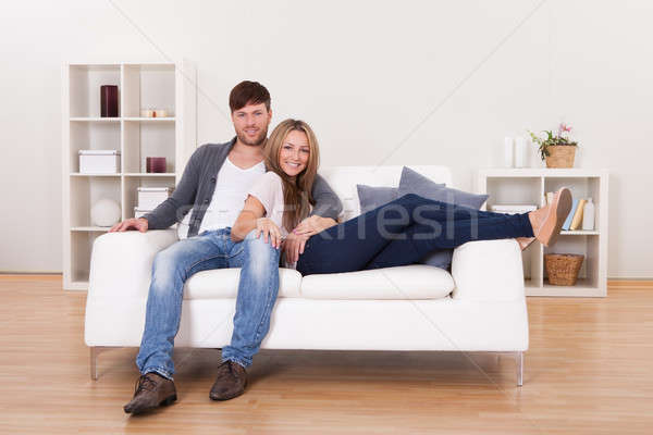 Stock photo: Couple sit on new couch