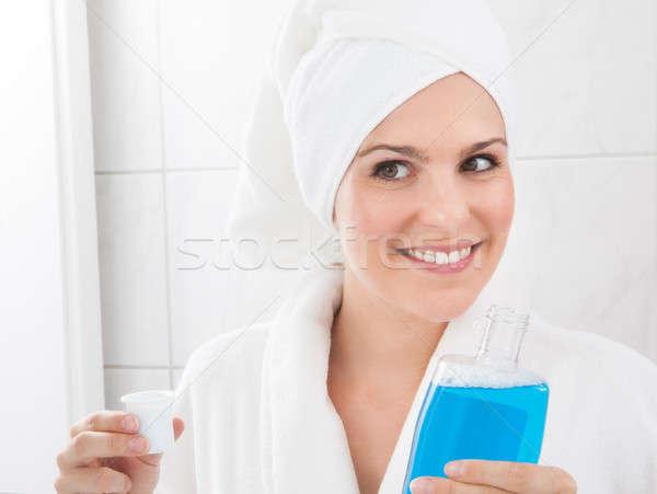 Woman Holding Bottle Of Mouthwash Stock photo © AndreyPopov