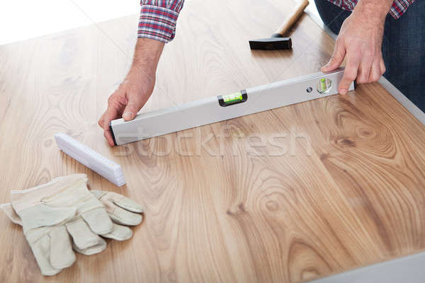 Worker working on laminate floor Stock photo © AndreyPopov