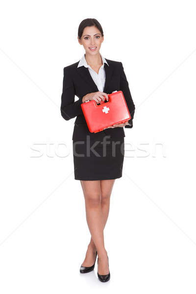Happy Businesswoman Holding First Aid Box Stock photo © AndreyPopov