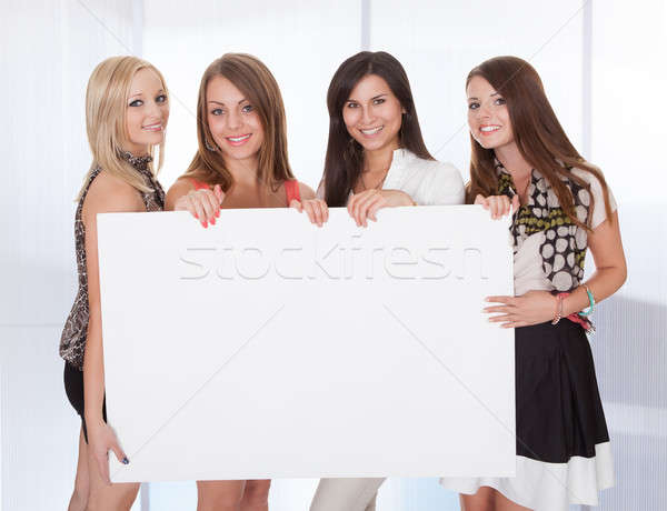 Four attractive women with blank sign Stock photo © AndreyPopov