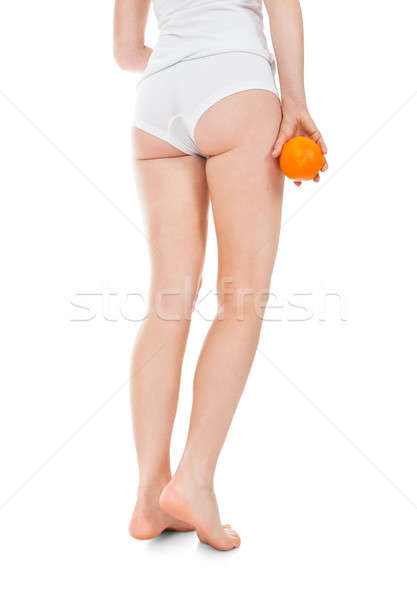 Low Section Of Woman Holding Orange Stock photo © AndreyPopov
