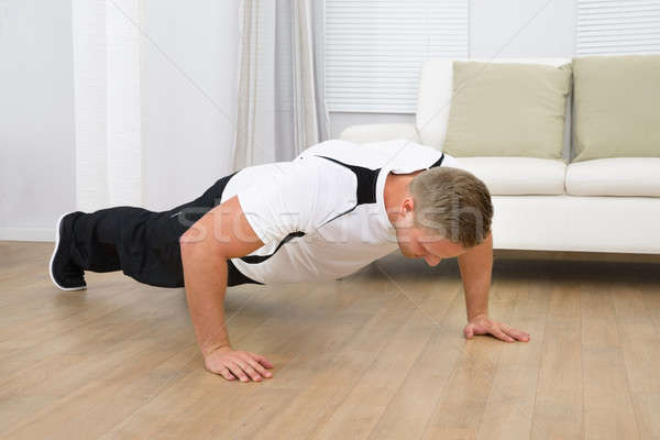 Healthy Fitness Man Doing Pushups Stock photo © AndreyPopov