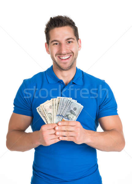 Férfi tart papírpénz portré mosolyog fiatalember Stock fotó © AndreyPopov