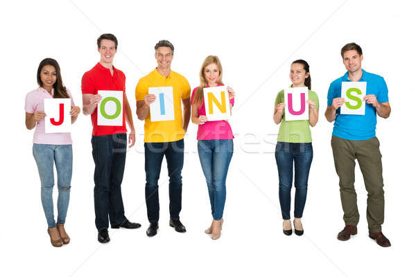 Multiethnic Group Of People Making Word Join Us Stock photo © AndreyPopov