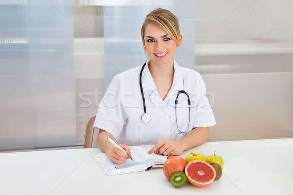 Female Dietician In Clinic Stock photo © AndreyPopov