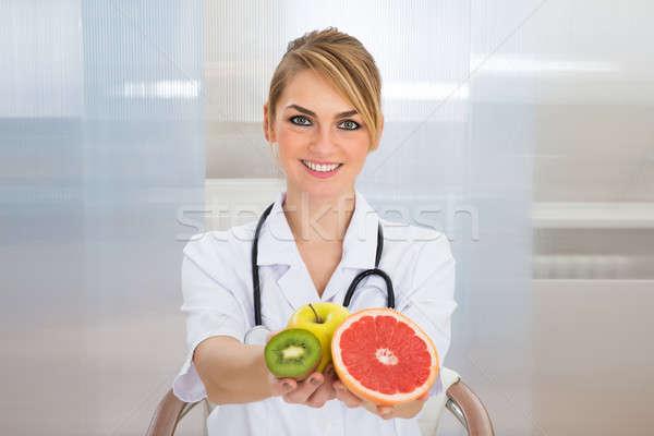 Homme fruits portrait heureux médicaux Photo stock © AndreyPopov