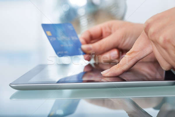 Woman With Credit Card Shopping Online Stock photo © AndreyPopov
