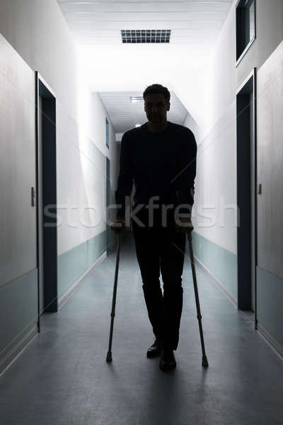 Man Walking With Crutches Stock photo © AndreyPopov