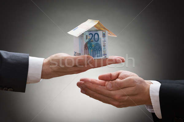 Businessman Giving House To The Businessperson Stock photo © AndreyPopov
