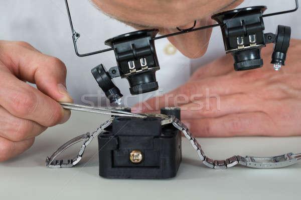 Watchmaker Repairing Wrist Watch Stock photo © AndreyPopov