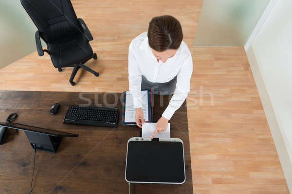 Young Businesswoman Using Printer In Office Stock photo © AndreyPopov