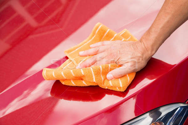Male Worker Washing Red Car Hood Stock photo © AndreyPopov