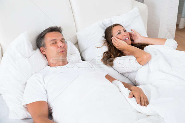 Stock photo: Woman Getting Disturbed With Man Snoring