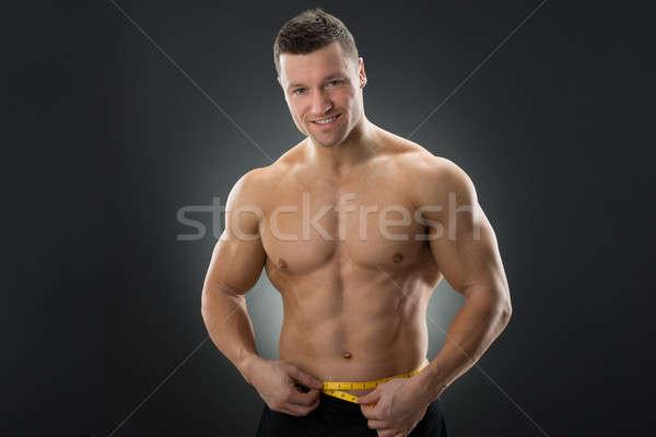 Muscolare uomo nastro di misura nero Foto d'archivio © AndreyPopov