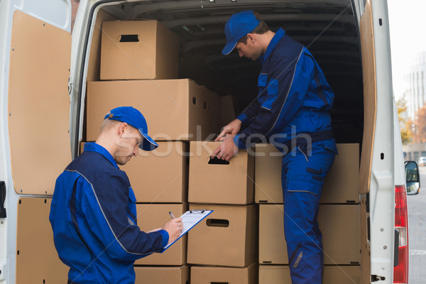 Delivery Men Unloading Boxes Stock photo © AndreyPopov