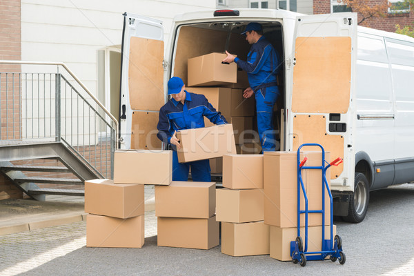 Delivery Men Unloading Boxes On Street Stock photo © AndreyPopov