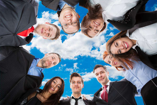 Diverse Business Team Forming Huddle Against Sky Stock photo © AndreyPopov