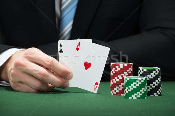 Poker Player Hand Holding Aces Of Club And Heart Stock photo © AndreyPopov
