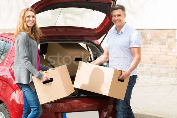 Couple Putting Cardboard Box In Car Trunk Stock photo © AndreyPopov