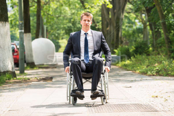 Young Disabled Man On Wheelchair Stock photo © AndreyPopov