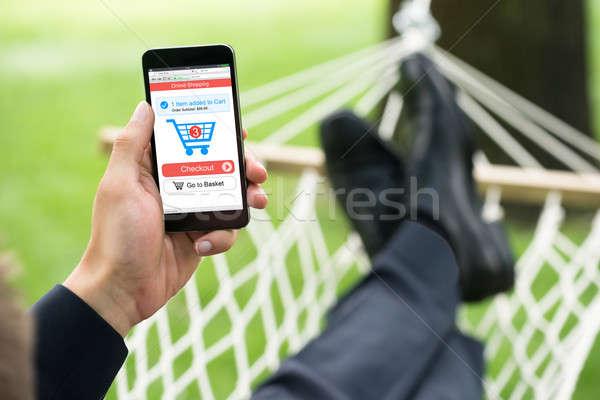 Foto stock: Pessoa · compras · on-line · telefone · móvel · maca