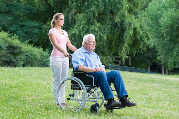 Woman With Her Disabled Father On Wheelchair Stock photo © AndreyPopov