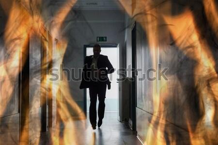 Person läuft heraus Feuer Flucht Silhouette Stock foto © AndreyPopov