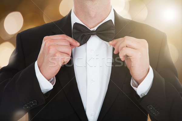 Man In A Tailcoat With A Bow Tie Stock photo © AndreyPopov