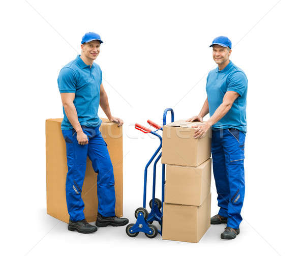 Courier Men Standing With Cardboard Boxes Stock photo © AndreyPopov