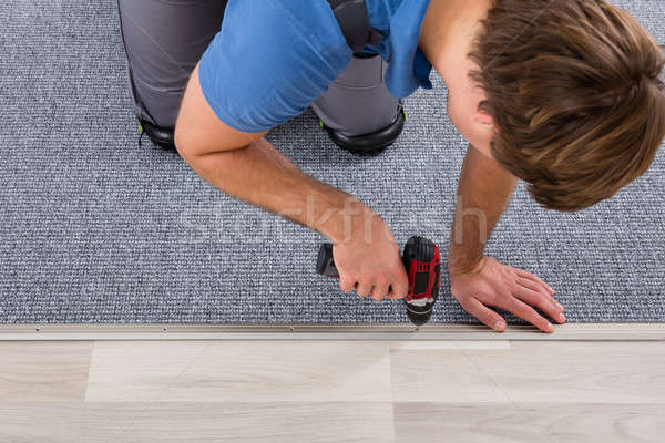 Person's Hand Installing Carpet On Floor Stock photo © AndreyPopov
