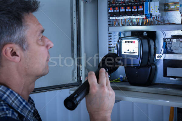 Electrician Examining A Fusebox Stock photo © AndreyPopov