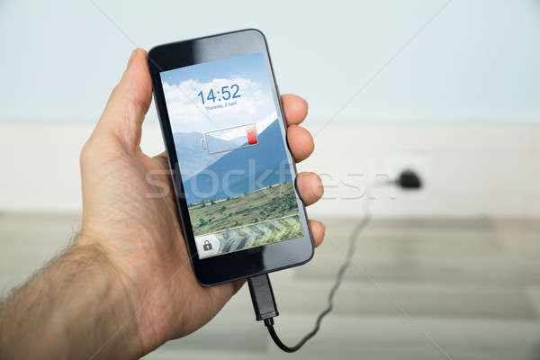 Person Charging His Mobilephone Stock photo © AndreyPopov