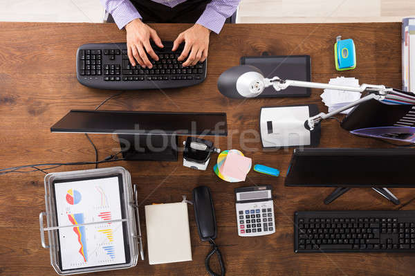 Elevated View Of Businessperson Working On Computer Stock photo © AndreyPopov