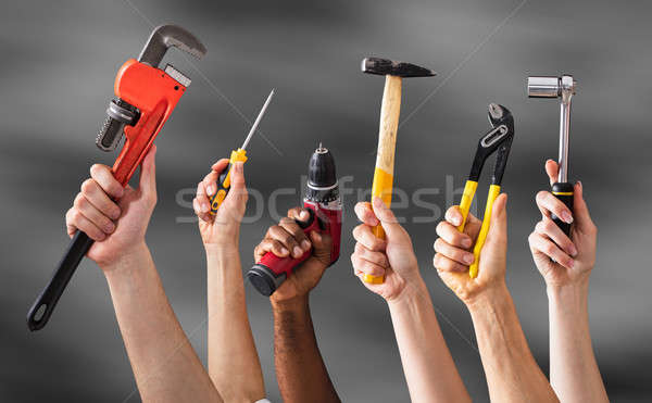 Hands Holding Work Tools Stock photo © AndreyPopov