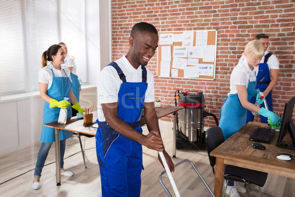 Happy Janitors Cleaning The Office Stock photo © AndreyPopov