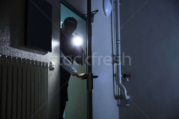 Male Security Guard Searching With Flashlight Stock photo © AndreyPopov