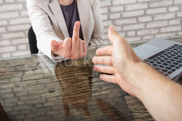 Businesswoman Showing Fuck Sign To A Person Shaking Hand Stock photo © AndreyPopov