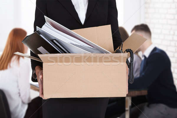 Businessperson Carrying Documents In Cardboard Box Stock photo © AndreyPopov