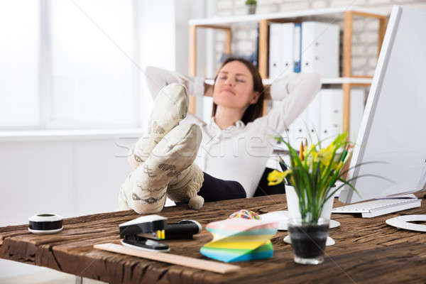 Fiatal üzletasszony alszik iroda visel zokni Stock fotó © AndreyPopov