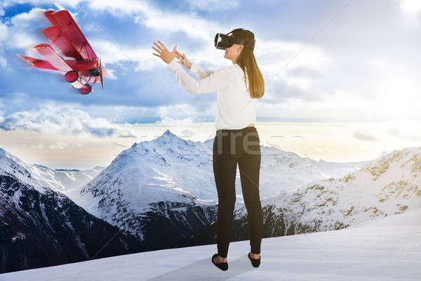 Avião voador mulher virtual realidade Foto stock © AndreyPopov