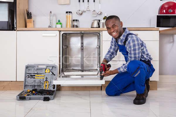Repairman Fixing Dishwasher Stock photo © AndreyPopov