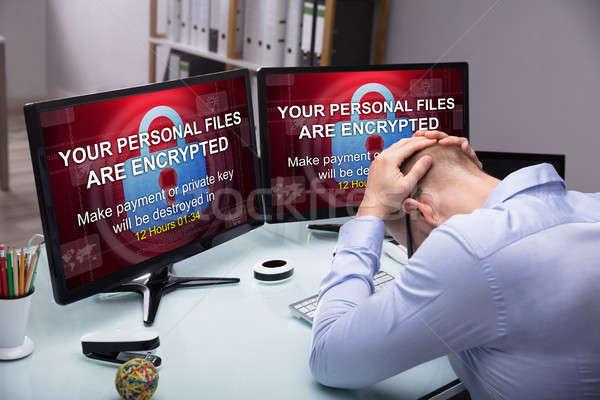 Hangsúlyos üzletember ül iroda képernyő mutat Stock fotó © AndreyPopov