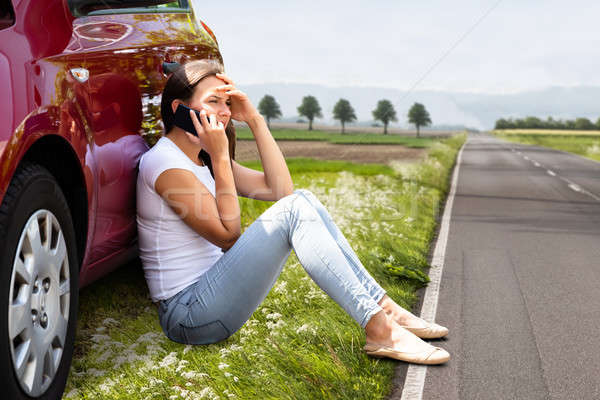 Woman Sitting On Road Near Breakdown Car Stock photo © AndreyPopov