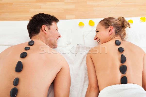 Couple enjoying a hot stone massage Stock photo © AndreyPopov