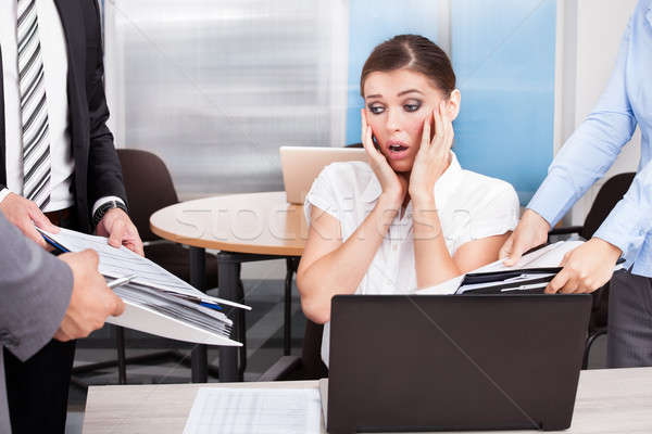 Shocked Businesswoman Looking At Folders Stock photo © AndreyPopov