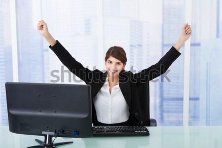 Jubilant businesswoman in office Stock photo © AndreyPopov