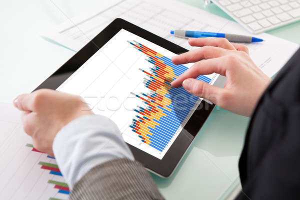 Stock photo: Close-up Of Hands Holding Digital Tablet