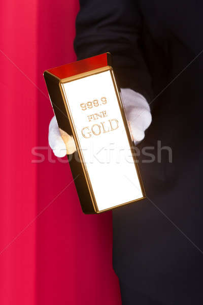 Magician Holding Bullion Stock photo © AndreyPopov