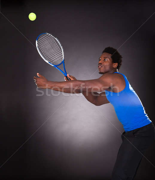 African Tennis Player Playing Tennis Stock photo © AndreyPopov